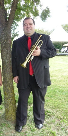 Vince Pettinelli outside with trumpet